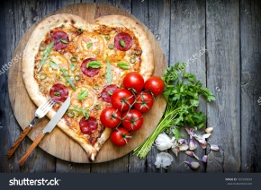 stock-photo-pizza-heart-shape-with-cheese-and-tomato-on-vintage-boards-181543934